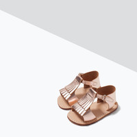 Fringe detail leather sandals