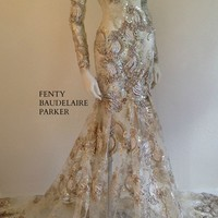The Fenty Baudelaire Parker Fancy Foxy, Sequins, Tinsel, Micro Fiber Embroidery Gown on mesh/net. Pattern Embroidery on hem of gown and sleeves