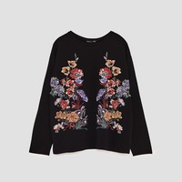 FLORAL RUBBERISED T-SHIRTDETAILS