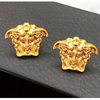 Versace New fashion human head earring Golden
