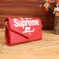 Red SUPREME Leather Clutch Bag