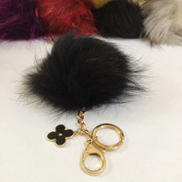 Fur pom pom keychain, bag pendant with flower charm in black