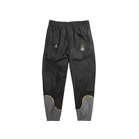 Air Jordan Men's Legacy AJ4 Woven Pants Anthracite Varsity Maize