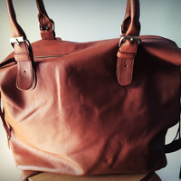 Brown leather tote.The best shoulder,cross body overnight bag.Tons of room,side pockets,fully lined.Durable genuine leather,customisable.