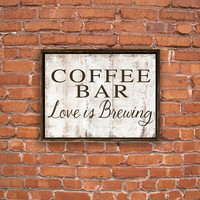 Coffee bar love is brewing wooden sign framed out in painted distressed reclaimed wood. Handmade. Approx. 11x14x2 inches.
