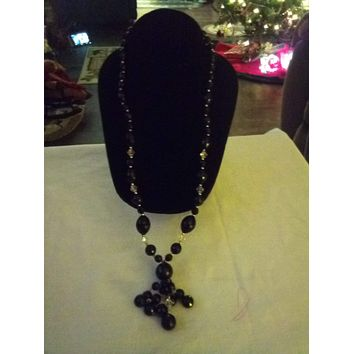 Long black different sized beaded necklace