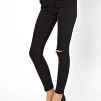 ASOS Low Rise Ultra Skinny Ankle Grazer Jeans in Washed Black with Rip Knee at asos.com
