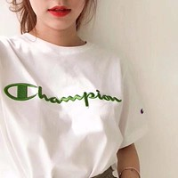champion crewneck t shirt with script logo