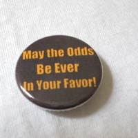 May the Odds Be Ever in Your Favor! (Hunger Games) 1.25 inch pinback button/magnet from Little House of Crafting