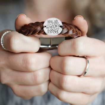 """""""Not All Who Wander Are Lost"""" Engraved Silver Coin Sewn on a Leather Bracelet"""