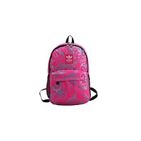 Adidas sells casual printed backpacks for men and women Rose Red
