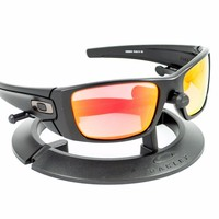 OAKLEY FUEL CELL MATTE BLACK FRAME / REVANT FIRE RED POLARIZED CUSTOM LENSES