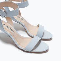 Mid-heel sandals with ankle strap