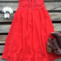 red dress with lace detail and buttons
