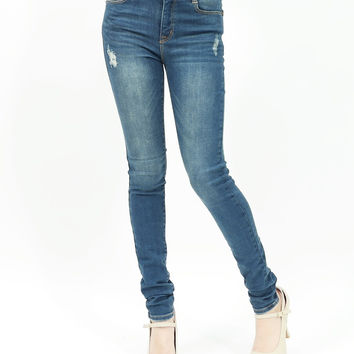 Distressed high waisted skinny jeans with back yoke detailed