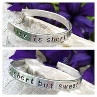 "Hand Stamped bracelet/cuff ""life is short but sweet for certain"" Dave Matthews Band"