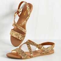 Strut, Look, and Glisten Sandal in Bronze