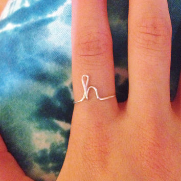 Initial ring lowercase cursive letter