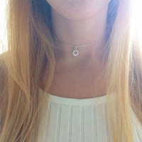 Little silver sun charm chain choker necklace on 11 inch silver plated chain with extender.