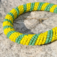 Yellow and green beaded bangle (elastic, spiral design, tribal African bangle / bracelet)