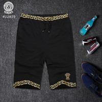 black and white Versace shorts