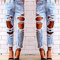 2016 New Women Cool Denim Jeans Boyfriend Jeans for Ladies Loose Wild Sexy Big Hole Ripped Jeans Female Washed Trousers