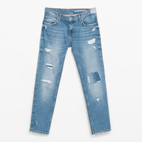 CIGARETTE JEANS WITH RIPS