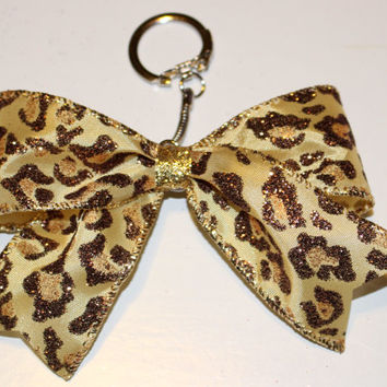 Cheetah Bow Keychain with gold middle and an opening and closing keychain