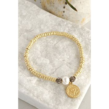 Gold layering bracelet with golden coin
