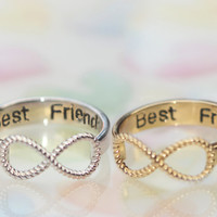 best friend/I love you Message containing an infinity ring .