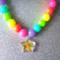 Crazy Neon Stretch Necklace with Gold Glitter Star from On Secret Wings