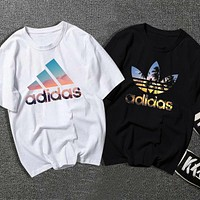 adidas Adidas clover short-sleeved t-shirt men and women loose couples cotton printed half-sleeved t-shirt tide
