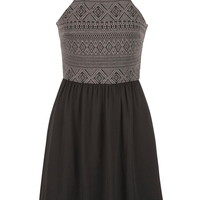 dress with high neckline and keyhole back