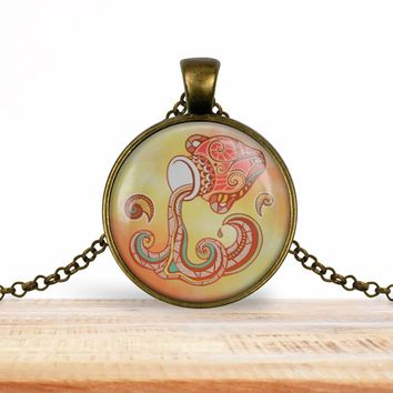 Aquarius zodiac pendant, tan, your choice of silver or bronze and necklace or key ring