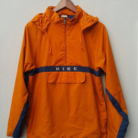 Orange navy blue PULLOVER HOODED nylon NIKE jacket windbreaker with zipper and front pocket, for running training, fits size L