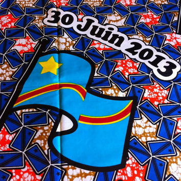 African Wax Print Fabric by the HALF YARD.  Congolese Flag with blue, tan, and orange pinwheels.