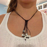 Multi-Strand Knotted Pearl Necklace with Leather Cord