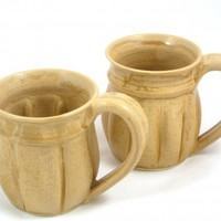 Pair of cocoa mugs with turned rim and notched body design