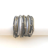 3X Wrap bracelet. Dark and light grey round leather with nickel chains and beads