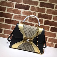 Gucci GG medium top handle bag