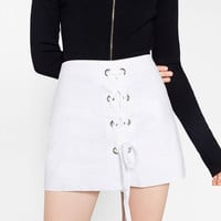 SKORTS WITH CRISS-CROSS STRAPS