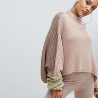PrettyLittleThing colour block balloon sleeve jumper in nude at asos.com