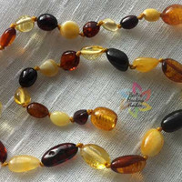 ADULT Baltic Bean Shaped Amber necklace designed with 100% Baltic bean shaped polished beads in mixed colors.