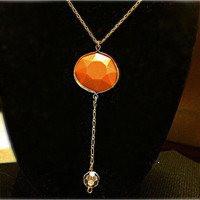 Peaches is one unique necklace! It's so chic, delicate, and adorable!