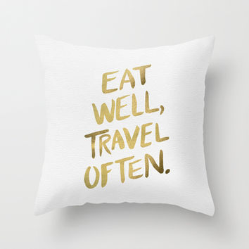 Eat Well Travel Often on Gold Throw Pillow by Cat Coquillette
