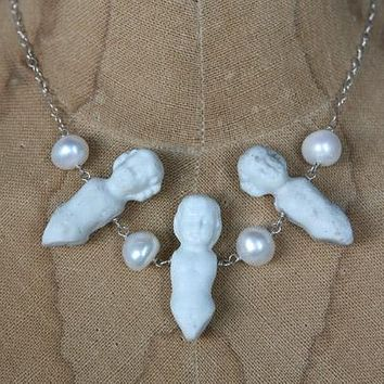 Antique porcelain doll necklace with pearls