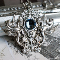 Antique silver victorian gothic necklace - winged seahorses and round glass cabochon
