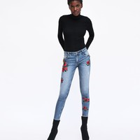 POWER STRETCH MID-RISE JEANS