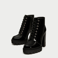 LACE-UP HIGH HEEL ANKLE BOOTS WITH TRACK SOLES
