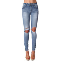 High waisted skinny jeans with ripped knees